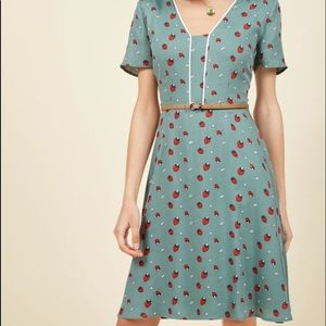 Adorable blue dress with strawberry print